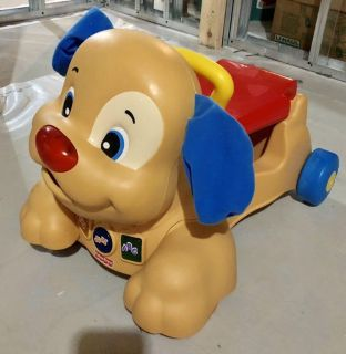 EUC Fisher price stride and ride puppy