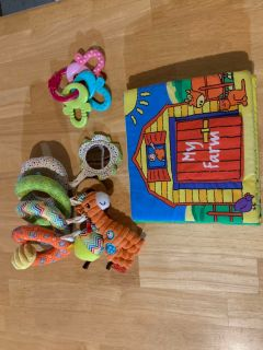 Baby carrier toy, keys, and plush book