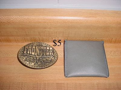 Vintage 1970's Frontier Hotel & Casino Las Vegas Brass Belt Buckle With Storage Pouch. The Belt Buckle Says FRONTIER HOTEL LAS VEGAS...