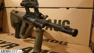 For Sale: Steyr Arms AUG with 1.5x Scope accepts AR15 magazines Bullpup Rifle chambered in 5.56 Nato Stock AR 15 Mag version