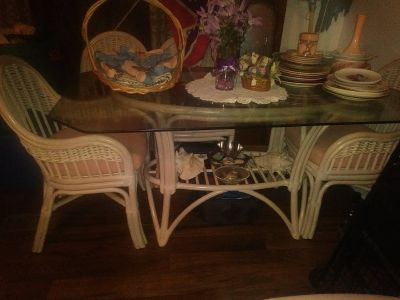 White wicker table with 6 chairs plus extras