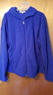 Zip up with good royal blue jacket size large has pockets