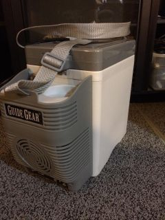 Portable car cooler. Works great!! Comes with cigarette lighter adapter and regular outlet adapter