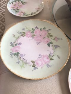 3 china plates trimmed in gold