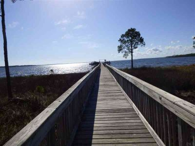 12995 Island Spirit Dr Pensacola, Waterfront lot with a boat