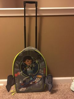 Miles from Tomorrowland suitcase with rollers. Lights up!