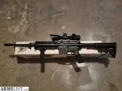 For Sale: Bushmaster AR-15 with extras