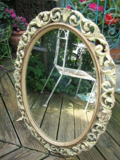 vintage scrolly wood oval mirror