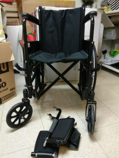 Wheel chair in box very new condition