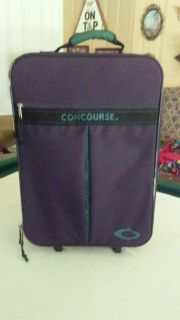 Concourse suitcase on wheels. Good condition $5