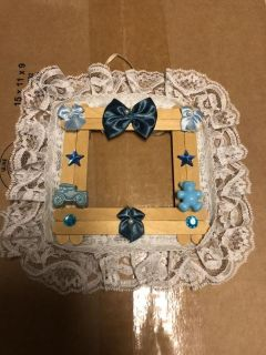 Homemade baby boy picture frame. $2.00
