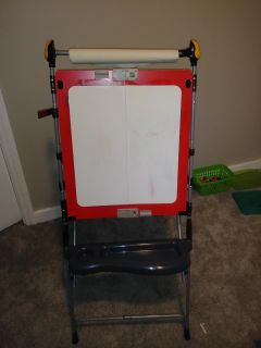 Dry erase /art easel. Comes apart for storage. Roll of paper hangs from top and clips on side hold in place.