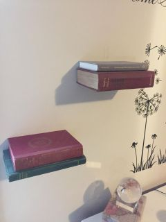 Floating shelves with vintage books included