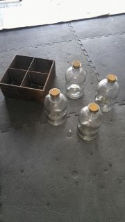 4 glass bottles with box