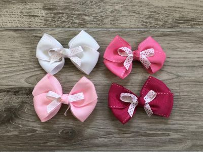 Set of 4 pink and white bows.