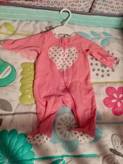 Pink sleeper with flower print from carters