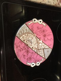 Antique plate with Bows