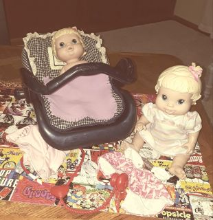 2 baby alive dolls and car seat
