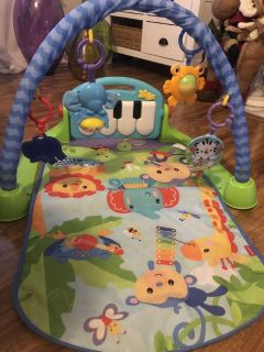 Like new fisher price piano that grows with your baby- can be adjusted. Mat can be removed. Arch can be removed.
