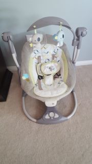 Ingenuity baby swing with music, nature sounds and swing setting. Gently used