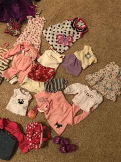 Tons of 18 doll clothes bag and shoe holder included