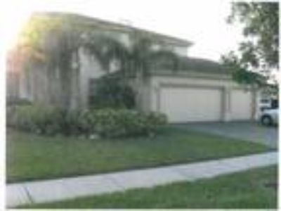 Bd 4/Ba 3 House for Sale in Royal Palm Beach