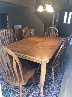 Wood table and 6 chairs with insert.