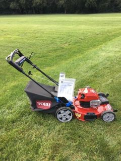 BRAND NEW NEVER MOWED WITH TORO 7.25HP MOW N' STOW PERSONAL PACE POWER REVERSE MOWER GREWAT SHAP...