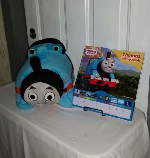 "Thomas the Train. Amazing. Train 18"" long turns into pillow. Thomas piano book plays great. Both for $10"