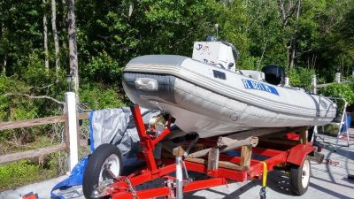 10foot 2inch Inflatable, centerr console,trailer & 20 Mercury