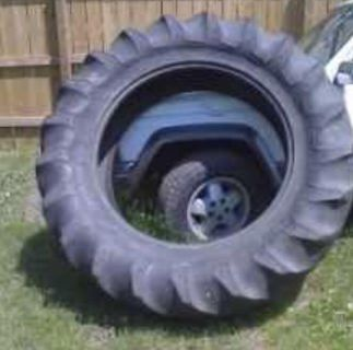 ISO large tractor tire in decent shape