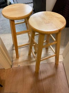 24 wooden stools