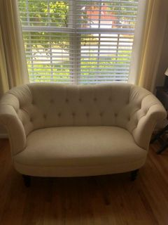 Pier One Imports Loveseat. Flax color for fabric.