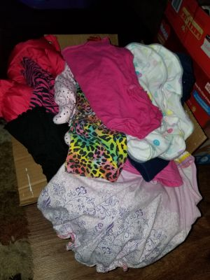 A small box of baby girl clothes
