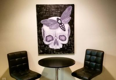 Skull and moth painting