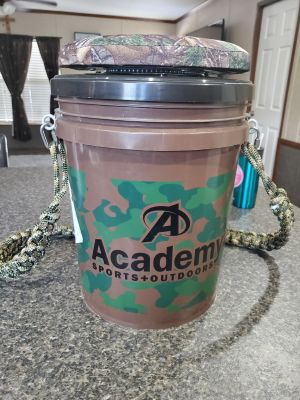 Bucket with braided handle and spinning cushion seat