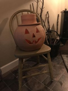 Very old wooden chair, a soft goldish color. It is missing a rung. But perfect on the porch holding a fall mum or your jack o lantern .