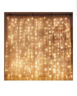 NEW. 10' x 10' warm white mini lights. Clear wire horizontal strand with vertical light strands. 300 LED lights