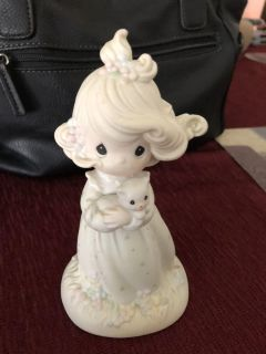 Precious moments. Girl holding cat. Great condition. $10.00