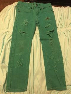 Size 6 boy jeans with rips. Dark green.