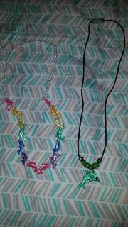 Lot 2-dolphin necklaces the colorful one is stretchy, and the green one is a breakaway closure