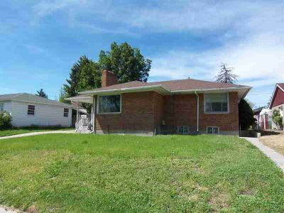 1252 E Pine Pocatello Four BR, This brick home features a roof