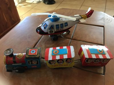 Nice vintage tin toys train and police helicopter