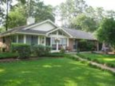 Multi-featured home near the golf course on .75 acre wooded/landscaped lot.