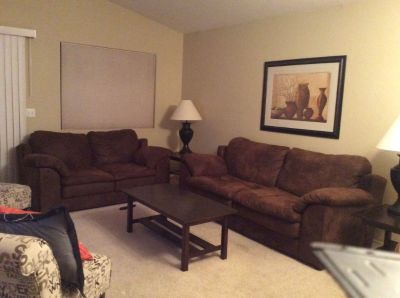 Sofa, love seat,end tables, coffee table, and two lamps.