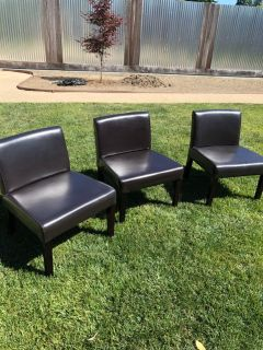3 faux leather chairs