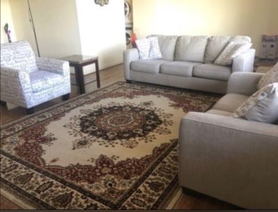 3 sofas with rug