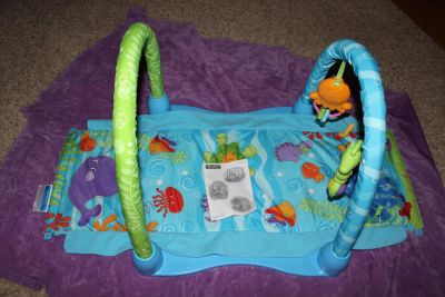 Fisher-Price Ocean Wonders Kick and Crawl Gym. 3 Different set up for the 3 different stages: On Baby's Back, Tummy Time, and Crawling