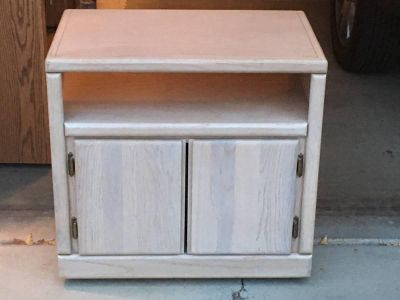 White washed cabinet on wheels