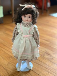 Vintage porcelain doll in great condition with stand